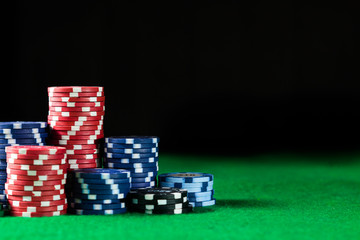 Casino poker chips on green table surface. gambling, fortune