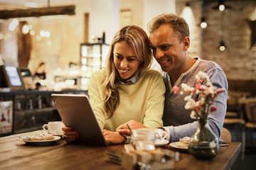 Couple looking at tablet computer together