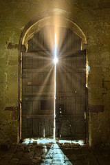 Door with solar rays in the Church of the castle of Turegano. Spain.