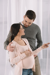 pregnant woman and husband looking at each other