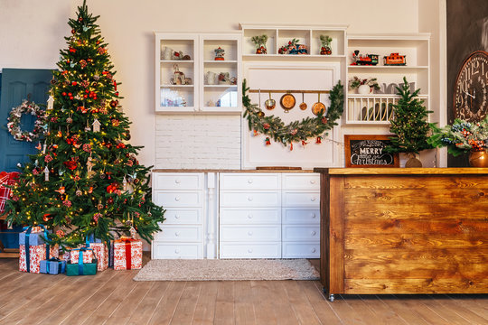 Christmas living room with a Christmas tree, gifts. Dining room. Beautiful New Year decorated classic home interior. Winter background
