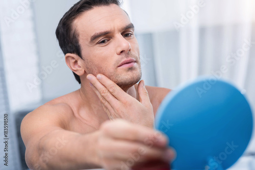 man holding mirror for irresistible young good looking man holding blue mirror and at it while ideal face