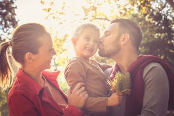 Happy family outside. Autumn season.