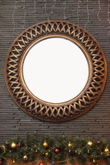 Round frame on a stone wall, and below Christmas decorations.Copy space.