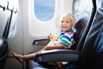 Child flying in airplane.Flight with kids.