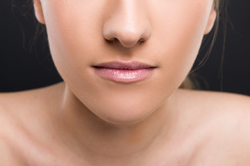 Closeup view of female lips with delicate lipgloss