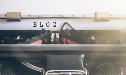 word BLOG written on vintage manual typewriter
