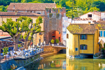 Mincio river and idyllic village of Borghetto view
