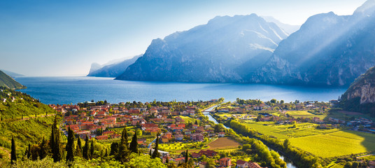 Town of Torbole and Lago di Garda sunset view Wall mural
