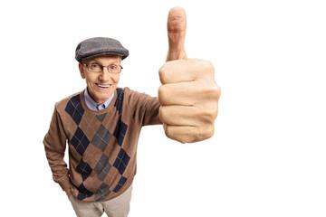 Senior making a thumb up gesture