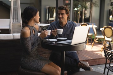 Couple having cup of coffee in chocolate bar