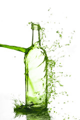 Bottle with liquid splash on white background