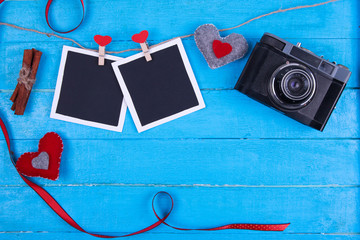vintage camera on a turquoise wooden background valentine's day