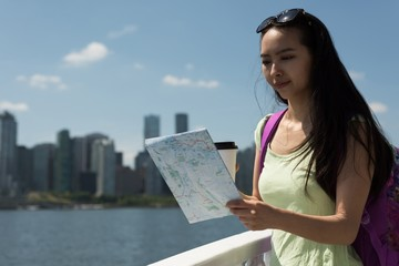 Asian woman looking at the map in the ferry