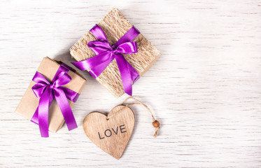 Holiday decorations with gift boxes and wooden heart. St. Valentine's Day. Copy space