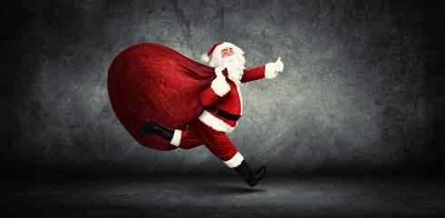 Weihnachtsmann mit einem Sack voller Geschenke! Wall mural