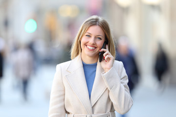 Happy lady calling on phone and looking at camera