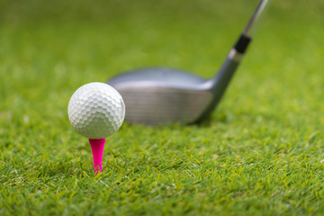 Shot of golf ball with golf club