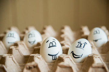 two funny smiling eggs in a packet.
