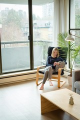 Woman using mobile phone in living room