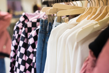 Fashion clothes on clothing rack in store. Sale, shopping, fashion, style concept.