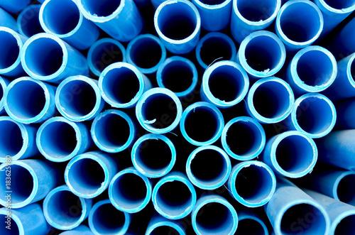 blue PVC tubes in storage, Plastic tubes, Background of PVC