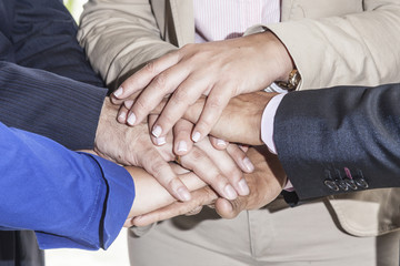 adult hands joined in symbol of teamwork
