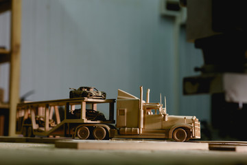 Wooden truck for transportation of cars. Side view closeup