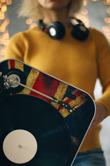Girl hold a turntable. Music concept and background