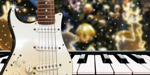 Christnas party music with piano and guitar at midnight time on christmas night blur background.
