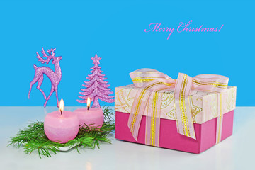 Christmas background, greeting card with two burning candles, decorations, gift and fir branches