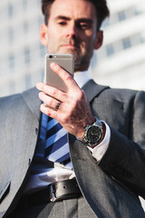 portrait of a businessman who handles a cellphone