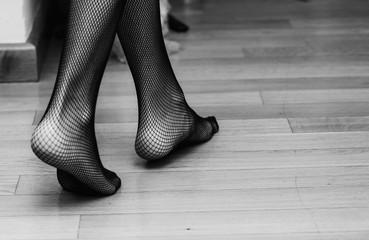 Unrecognisable model wearing fishnet stockings