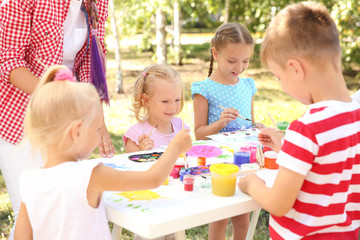 Children at painting lesson outdoors