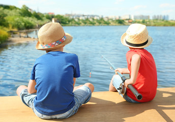 Cute children fishing on summer day