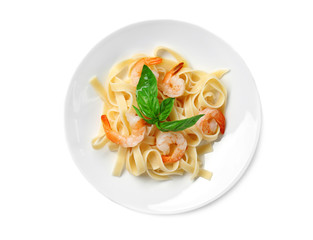 Plate of tasty pasta with shrimps on white background, top view