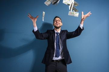 Stock exchange broker with money on color background