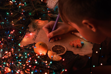 Boy writes a letter to Santa, cristmas background