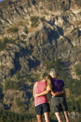A mother and daughter share a tender moment and soak in the beauty on a Summer hiking adventure.