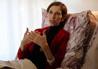 Hunger-striking literature professor Nuriye Gulmen speaks during an interview with Reuters at her home in Ankara