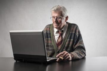 Elderly man using a laptop
