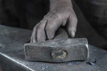 Close-up of blacksmith holding hammer