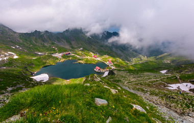 mountain lake Balea view through the clouds. amazing summer landscape of one of the most visited landmarks in Romanian Fagarasan mountains