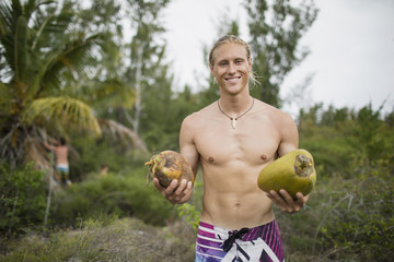 Portrait of man with fresh picked coconut