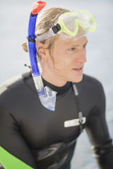 Man with snorkeling equipment