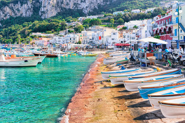 Fotobehang Napels Boats at Marina Grande embankment in Capri Island Tyrrhenian sea