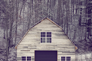View of abandoned wooden barn in winter