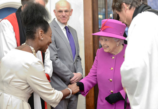 Britain's Queen Elizabeth talks to Floella Benjamin at the Scripture Union's 150th anniversary service of celebration at St Mary's Church, in London