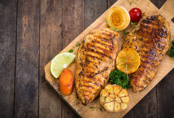 Grilled chicken breast on the cutting board