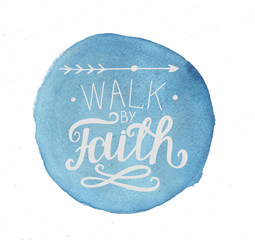 Hand lettering Walk by faith, made on a blue watercolor background